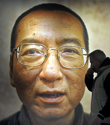 Workers prepare the Nobel Peace Prize laureate exhibition for Chinese dissident Liu Xiaobo at the Nobel Peace Center in Oslo
