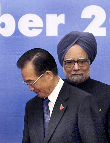 China's Premier Jiabao walks past PM Dr Singh during the 5th East Asia Summit in Hanoi