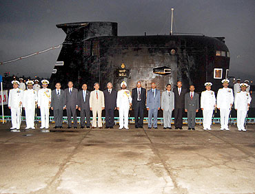Flag Officer Commanding in Chief Vice Admiral Anup Singh with dignitaries and first crew members onboard Vagli