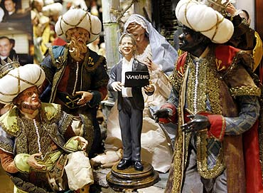 A figure of Wikileaks founder Julian Assange is placed in a Neapolitan Christmas creche by Gennaro Di Virgilio depicting the Nativity of Jesus in Naples