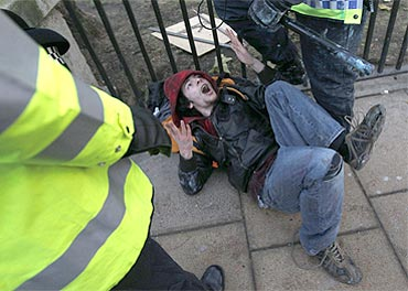 Demonstrators clash with the police during a protest in Westminster