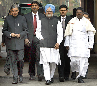 PM Dr Singh walks out of the Parliament with Parliamentary Affairs Minister Pawan Kumar Bansal (right) and Junior Minister V Narayanswamy