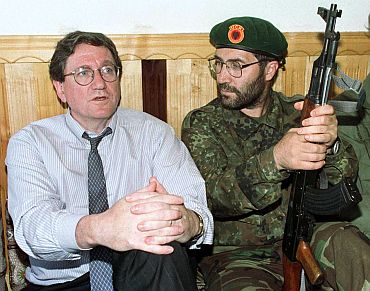File image shows Holbrooke, then US envoy to the Balkans, sits with an unidentified Kosovo Liberation Army soldier at their headquarters in Junik. The picture was taken on June 24, 1998