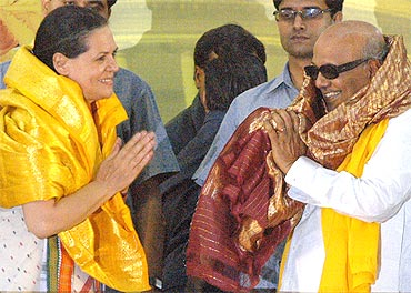 Congress chief Sonia Gandhi greets Tamil Nadu CM M Karunanidhi during a rally in Chennai