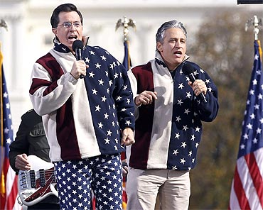 Comedians Jon Stewart and Stephen Colbert sing during the 'Rally to Restore Sanity and/or Fear'