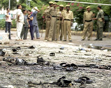 Security personnel at the site of a bomb blast in Ahmedabad on July 27, 2008