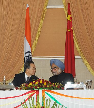 'India must do lot of homework to overtake China'