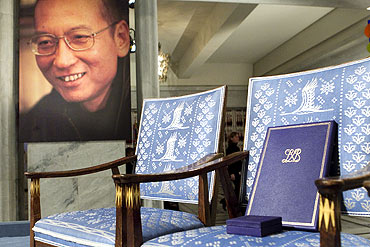 The Nobel certificate and medal is seen on the empty chair where this year's Nobel Peace Prize winner jailed Chinese dissident Liu Xiaobo would have sat