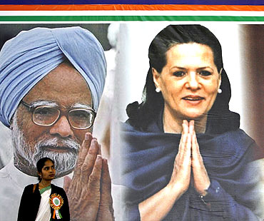 Posters of Sonia Gandhi and Prime Minister Manmohan Singh