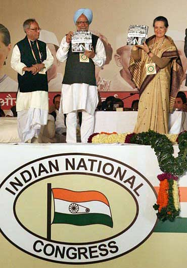 Finance Minister Pranab Mukherjee with Prime Minister Dr Manmohan Singh and Congress President Sonia Gandhi at the plenary