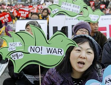 Protesters shout slogans during an anti-war and anti-government rally in Seoul