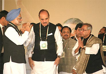 PM with Health Minister Ghulam Nabi Azad (centre) and Finance Minister Pranab Mukherjee (right) at the plenary meet on Monday