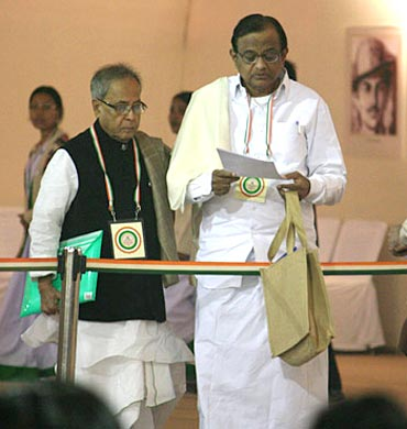 Home Minister P Chidambaram with Finance Minister Pranab Mukherjee at the Congress plenary meet at De