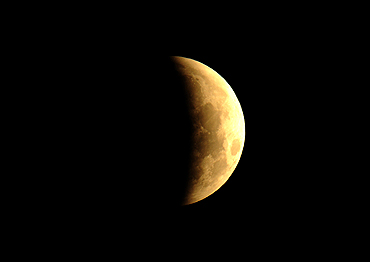 The shadow of the Earth is seen on the Moon during a total lunar eclipse