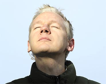 Julian Assange pauses as he speaks to the media in Norfolk, England