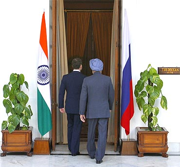 President Medvedev and PM Singh walk before their meeting in New Delhi on Tuesday