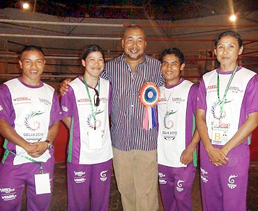 Mary Kom, second from left, with her coach Leishangthem Ibomcha Singh and other boxers