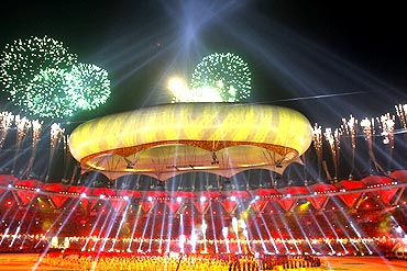 Fireworks explode over the Jawaharlal Nehru stadium during the Commonwealth Games closing ceremony in New Delhi