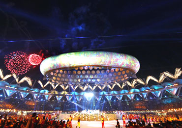 Fireworks illuminate the Jawaharlal Nehru Stadium during the Commonwealth Games opening ceremony