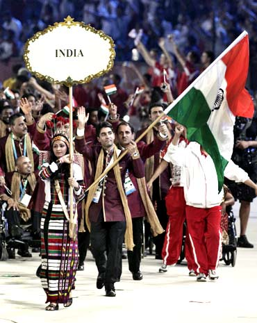 India's flag bearer Olympic gold medalist  Abhinav Bindra leads his team into the stadium