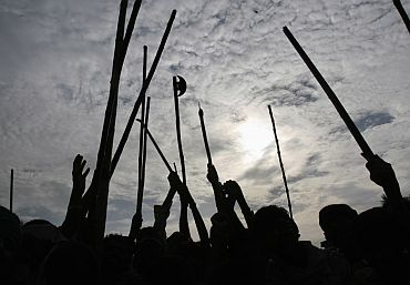 Ethnic Gujjar men shout slogans as they block a national highway during a protest in Sikandra, Rajasthan