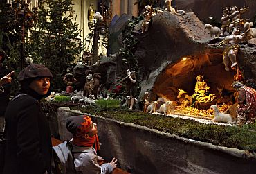 People look at the nativity scene during a Christmas celebration at the Croatian capital Zagreb's Roman Catholic cathedral