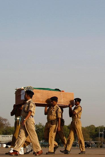 Policemen carry the coffin of one of their colleagues, killed in an encounter with Naxals in Dantewada