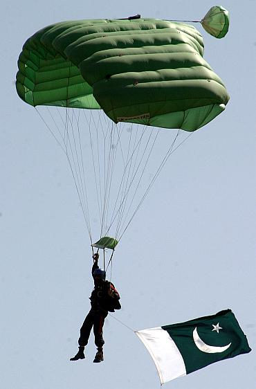 A Pakistani paratrooper from the Special Service Group (SSG) lands on the ground during a mock anti-terror exercise in Cherath.