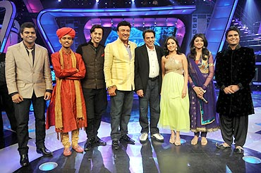 Sreeram, left,  with Bollywood legend Dharmendra, judges of the show, and other contestants
