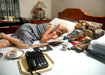 A senior, Rita Sikand sleeps in a pay for stay home in Delhi