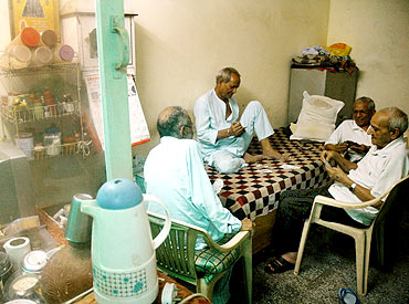 Seniors at Gharaunda, a charitable old age home on the outskirts of Delhi, play cards