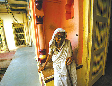 A woman rests in an old age home in the pilgrimage town of Vrindavan.