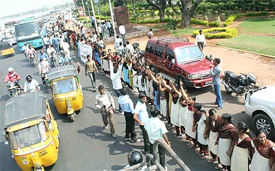 Schoolchildren join the massive human chain for Telangana in Hyderabad on Wednesday