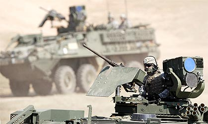 A US Army soldier sits atop a Stryker, an eight-wheeled armoured combat vehicle, during Yudh Abhyas.