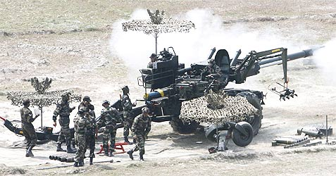 Indian army soldiers fire Bofors gun during a military exercise