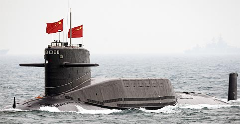 A Chinese Navy nuclear submarine takes part in an international fleet review