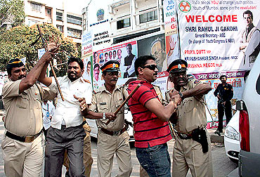 Two Sena activists being taken into custody at Vile Parle