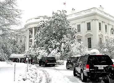 United States President Barack Obama's motorcade stands in front of the White House