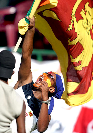 A Sri Lankan waves his country's flag