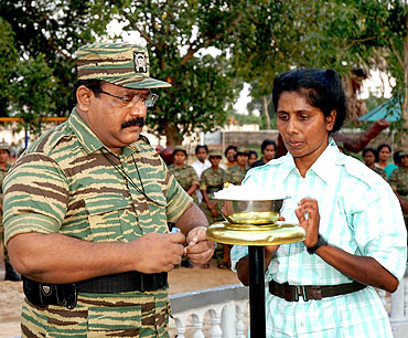A file photo shows LTTE chief Prabhakaran lighting up a traditional lamp as he opened a new Sencholai campus, a children's home established to care for children who lost both parents in the war, in Tamil Tiger held Kilinochchi