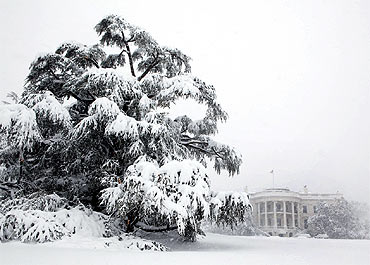 Snow blankets the White House south grounds during a blizzard
