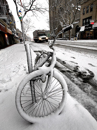 A bike is covered by snow in Brooklyn, New York