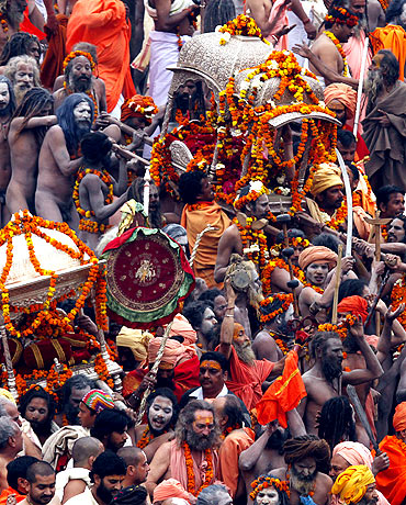 Sadhus carry palanquins to the banks of the Ganges in Haridwar