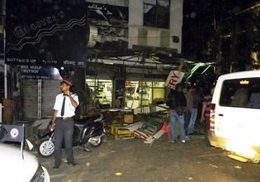 Investigators at the site of the blast in Pune