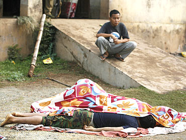 Bodies lie in the grounds of a police camp that was attacked by Maoist rebels
