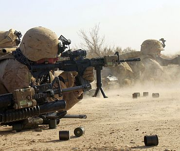 US Marines from Bravo Company of the 1st Battalion, 6th Marines, fire their weapons in the town of Marjah in Nad Ali district of Helmand province