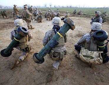 US Marines from Bravo Company, 1st Battalion, 6th Marines, take a break