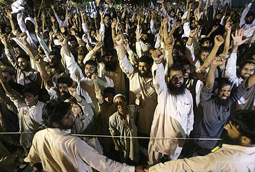 Pakistani activists of the Islamic hardliner party Jamaat-ud-Dawa shout anti-India slogans during a r