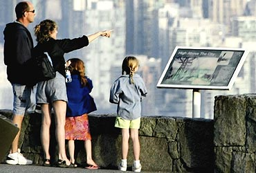 The downtown core of Vancouver, British Columbia is seen in the background as tourists take in the view from Cypress Mountain on the north shore