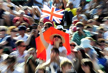 A spectator waves the British flag